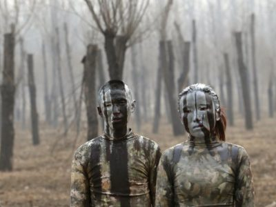 Artist Liu Bolin Uses Bodypaint to Critique Pollution in China